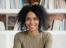 Millennial brunette woman tutoring mathematics online